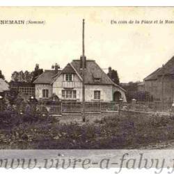 Ennemain - Un coin de la place et le monument