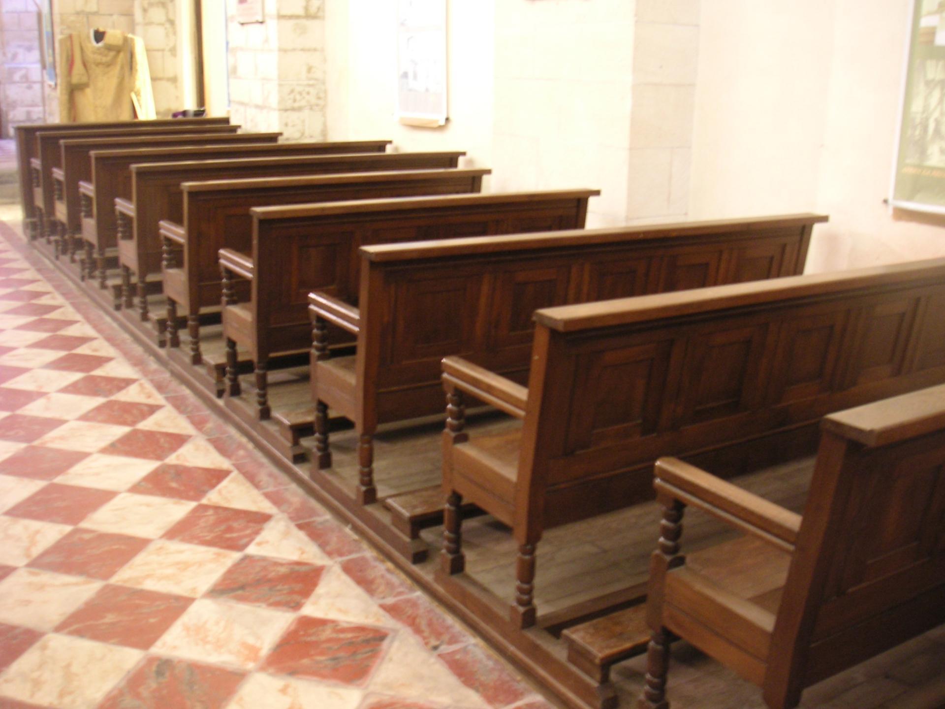 Le mobilier bois (confessionnal, les bancs de la nef, les stalles...) a été conçu par ?